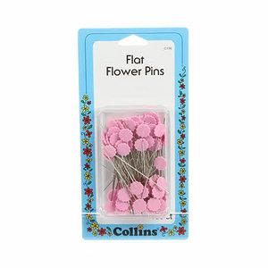 Knappnålar med rosa blommor
